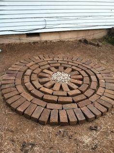 DIY: Brick Patio Tutorial Good for area between raised beds and sidewalk. Fit in rocks, etc. in pattern.