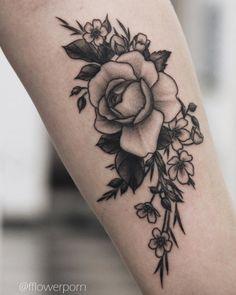 Black and grey ink rose tattoo by Olga Nekrasova