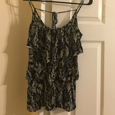 Size Small - Floral Black & White halter top Size Small - floral print halter top - Lightly used and will go great with any outfit! All prices negotiable within reason!! a'gaci Tops Tank Tops