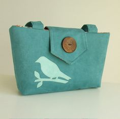 Bird on a purse.
