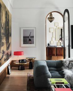 INTERIORS: From the latest issue of Vogue Living, it requires a blend of courage and care to undertake a home remodel in a heritage precinct, but @b.e_architecture brought the right combination to this terrace home in Melbourne's St Vincent Place. Here, in the living room, B&B Italia Tufty-Two sofas by Patricia Urquiola from @spacefurniture ; ClassiCon Bell side tables by Sebastian Herkner from @aniboufurniture ; coffee table with built-in perspex boxes by BE Architecture; artworks include…