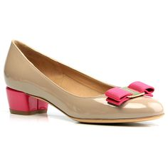 Classic Ferragamo pump with iconic signature bow in a contrasting color. Patent leather and gold-tone metal ornament. Leather lined. $550