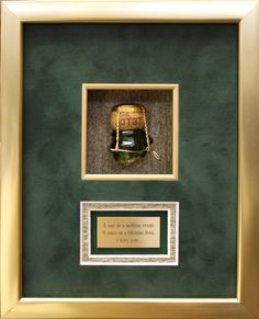 Framed champagne cork shadowbox with gold frame and matching inner fillet frame. Customized with textured cork matboard and gold plate.   Designed and framed at Art & Frame Express.