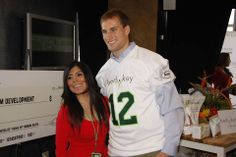 Long-time Nutrilite sports ambassador Kirk Cousins takes pictures with the media in attendance.