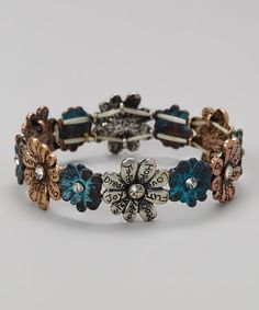 Add a bit of positive power to the day with a gorgeous accessory. This piece promises to catch compliments and earn adoration with its bohemian style and touch of shimmer.