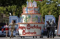 A giant cake float is pushed down Olive Avenue during the Burbank on Parade, saluting the city of Burbank's centennial on Saturday, April Giant Birthday Cake, Giant Cake, Birthday Cakes, Homecoming Floats, Homecoming Parade, Text Features First Grade, Carnival Floats, Christmas Parade Floats, 4th Of July Parade