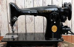 Singer 201 Sewing Machine; resembles a 66, but has the narrow neck, and round plate stitch length lever.I believe it has the rotary hook.