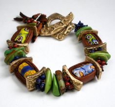 by Deb from Febra Rose | A Beaded Bracelet Featuring Antique Venetian glass beads from the African Trade, Handcrafted Bronze PMC, Mohave Green Turquoise, Leather, Coral and Lapis