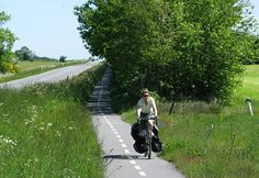 Sandra enjoying a Danish cycle path...  Denmark has a network of national, regional, and local cycle routes, some of which are the tarmac cycle paths alongside normal roads and others are rough tracks that go off into the country, through fields and forests, winding their way through beauty spots and places to picnic or sit beside a lake.