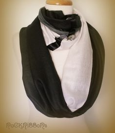 Black and white winter circular infinity scarf pashmina in eco friendly warm acrylic blend with wide satin ribbon trim and large mother of pearl shell buttons.