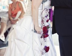 Decorated crutch instead of a handheld bouquet for a #disabled bride. Decorated with live flowers and beading.