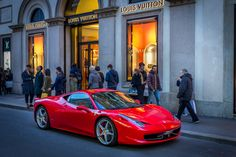 Red in front of on Via Montenapoleone. A classic cliché combination.