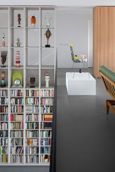 The resident's art collection, which comprises around 100 pieces, is displayed throughout the two levels of this loft-style home designed by i29. Apartment Projects, Apartment Interior, Apartment Design, Loft Spaces, Storage Spaces, Loft Style Homes, Open Plan Apartment, Amsterdam Apartment, Niche Design