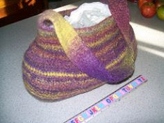A fun handbag made from the bottom up. Great for scraps of wool or multi-coloured wools. A sturdy felted bag that will be useful for a number of occasions and uses.