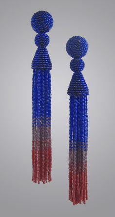 Cobalt and Ruby Red Beaded Tassel Earrings by Julie Long Gallegos. Long and sinuous, these tassel earrings descend from cobalt to ruby, shading through subtle plum. These are created with Charlottes, manufactured under strict control in the Czech Republic. They are the top of the line, and their subtle, elegant shimmer is due to the single facet on each bead. To wear day into evening. For pierced ears with sterling silver posts, and comfort disk backs. Very lightweight. 5