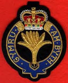 "Uniform badge of the Welsh Guards. The wording translates from Welsh into ""Wales For Ever"""