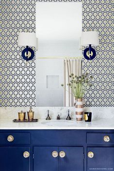 Blue and white Bathroom, Navy cabinets and wallpaper.