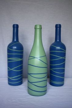 Spray paint a bottle and let dry. Place rubber bands around the bottle and spray paint with a contrasting color. Once the paint is dry, take the rubberbands off, and you have a piece of art!