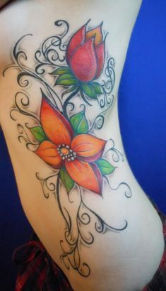Color Flowers Tattoo Inked On Ribs  By: MANUEL DIOSDADO TATT ARTIST