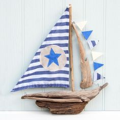 large plaster nautical mirror | Home ~ coastal living ~ large driftwood boat - star and stripes sail