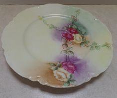 Lovely Haviland decorative plate. Roses on light green back, with decorative edging, 7 diameter, and marked: Haviland France, REB. I see no