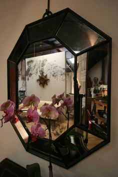 mirror decorated with fake floral and greenery