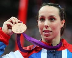 Gymnast Beth Tweddle claims her first Olympic medal, winning bronze in the Uneven Bars