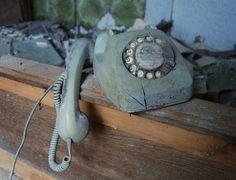 broken dial telephone.  Lost Place Urban Exploration https://www.facebook.com/ForgottenHideaways Copyright by ForgottenHideaways