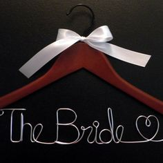 Personalized Wedding Hanger / Choose Finish and Ribbon Color / Name Hanger / Wedding Gown Hanger. $5.50, via Etsy.