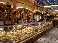 HARRODS LONDON DEPARTMENT STORE   FOOD HALLS ~ CHEESE DEPARTMENT  Harrods is a luxury department store located in Brompton Road in Knightsbridge, in the Royal Borough of Kensington and Chelsea, London.
