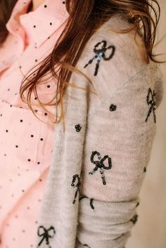 pink and black polka dot shirt with bow print cardigan