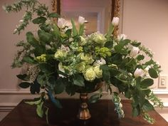 Green and white centerpiece for event. Cotedesignsfloralsevents