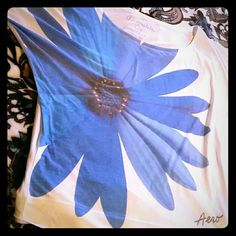 Ladies Dolman Top Ladies Aeropostale Dolman too with giant blue daisy. This shirt can be worn on or off the shoulder. Super cute for the spring. Worn maybe 2 times, no damage, little wear. Aeropostale  Tops Tees - Short Sleeve