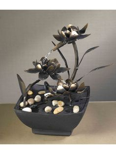 The Cadino Metal Flower Tabletop Fountain is a great choice for any tabletop. Unique water lilies, features water dancing from flower to flower. This unique tabletop water feature could be placed eith
