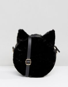 2e0522965 http://www.asos.com/au/monki/monki-cat-ear-faux-fur-cross-body-bag /prd/7298342?iid=7298342&clr=Black