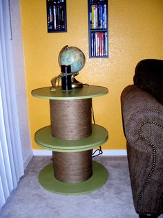 My roommate and I found these huge spools at Resource.  We put two together, painted them, and wrapped jute around the stem. $15 side table with some character : )