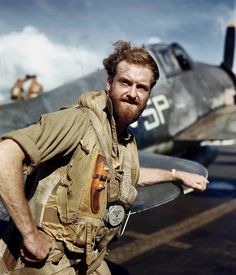 Pilot of the Fleet Air Arm, Royal Navy with his Hellcat fighter. Far East, 1945