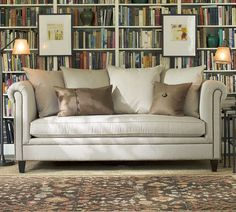 Ticking couch, wall-to-wall bookshelves, don't mind if I do.