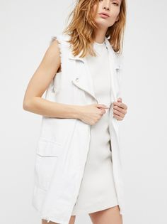 Long Moto Vest | Long moto style vest featuring a zip front closure with outer pockets and frayed edges for a lived-in look.