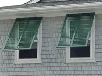 Bahama shutters add to the beauty of your home and protect it's contents.  www.crawforddoorsystems.com #stormprotection #hurricane #windows #shutters