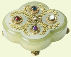 A Faberge bell-push, made of enamel, bowenite, gold, sapphire, amethyst, moonstone and diamond. In the Royal Collection, about 1900.