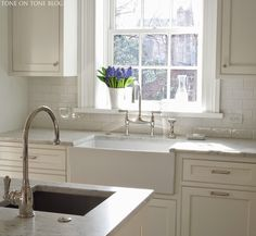 Tone on Tone: farm sink from Shaw & polished nickel faucets from Rohl