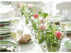 I love this!  The low flowers make for easy conversation, and the simple arrangements keep it fresh.  Could be for a luncheon, dinner or an event like a wedding. Best of all, the blog this came from says the glassware in IKEA!  That means I can afford to duplicate it! :-)