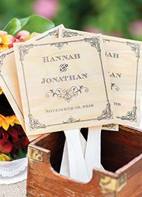 """A thoughtful item for spring summer and fall weddings favor fans will not only keep guests cool but also be a wonderful memento of your wedding. Square wood veneer favor fans are decorated with a vintage filigree design and plastic handles.  Features and Facts:  Set of 24  Measures 5"""" x 5""""  Material: Wood veneer  White plastic handle and adhesive strips included  Customer assembly required  Personalize with bride and groom's first names up to 15 characters each including spaces, and ..."""