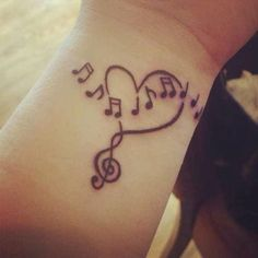 http://tattoomagz.com/gorgeous-music-style-tattoo/black-heart-music-style-tattoo/