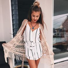 love the cardigan and her hair and accessories, but I would wear something else underneath