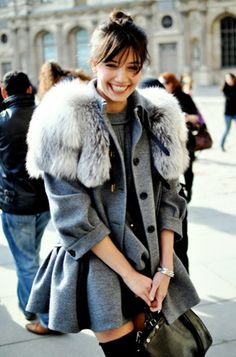 Love the coat and her smile :) #fashion #streetstyle #trends #fur #outer
