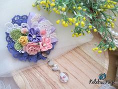 Hana Madoka Brooch Size : 8,5 cm Colours : pastel purple Materials : ribbon flower, fabric flower, lace and beads