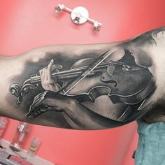Lovely black and grey violin tattoo by Matteo Pasqualin.