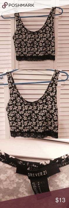 Floral and Lace Cropped Tank Adorable floral and lace cropped tank, only worn one or two time. In pristine condition. TAGS: Levi's, Victoria's Secret, VS, VS Pink, Forever 21, Charlotte Russe, Zara, Adidas, Puma, Yeezy, Sephora, Urban Outfitters, H&M, Urban Decay, Steve Madden, Free People, Marc Jacobs, Michael Kors, Kylie Jenner, Kylie Cosmetics Forever 21 Tops Crop Tops